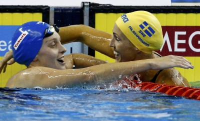 Alshammar of Sweden is congratulated by Halsall of Britain after winning women's 50m freestyle final at 14th FINA World Championships in Shanghai