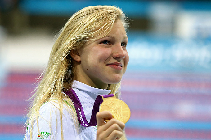 LONDON, ENGLAND - JULY 30:  Ruta Meilutyte of Lithuania holds up her gold medal during the medal ceremony for the Women's 100m Breaststroke on Day 3 of the London 2012 Olympic Games at the Aquatics Centre on July 30, 2012 in London, England.  (Photo by Al Bello/Getty Images)